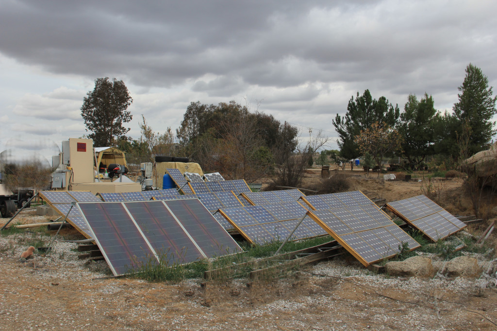 Artist Hangout - Rammed Earth House Construction 48 - Solaterre's Ground Mounted Solar Panels