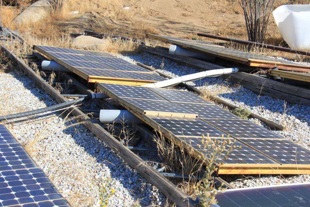 Artist Hangout - Rammed Earth House Construction 49 - Solaterre's Ground Mounted Solar Panels