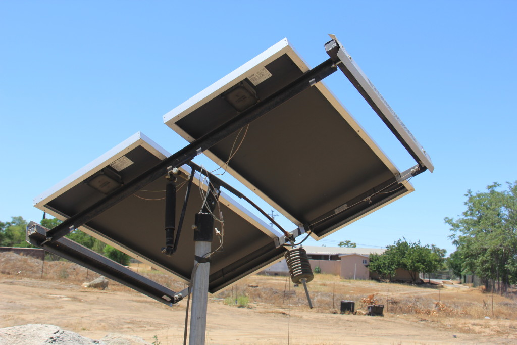 Artist Hangout - Rammed Earth House Construction 51 - Solaterre's Pole Mounted Solar Panels