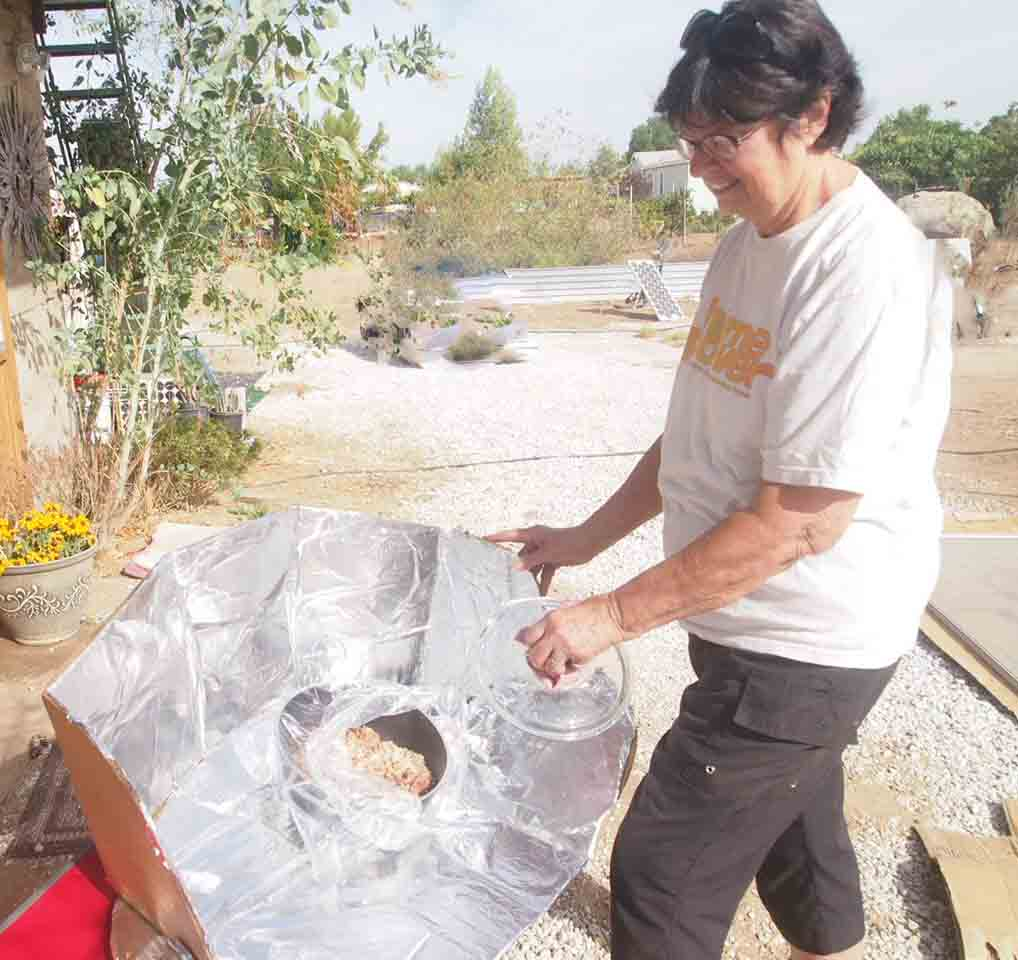 Artist Hangout - Rammed Earth House Construction 60 - Sharon cooking with solar power